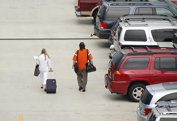 People Walking through Airport Parking Lot (Photo: Thinkstock/iStock)