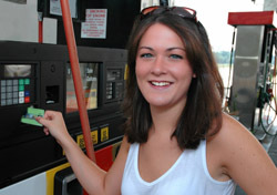 Car: Woman Paying for Gas (Photo: Shutterstock/Danny E Hooks)