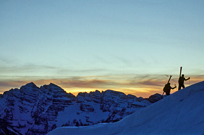 Two skiers hike the Aspen backcountry at sunrise