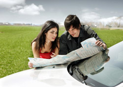 Couple looking at a map on their car (Photo: iStockPhoto/Lise Gagne)