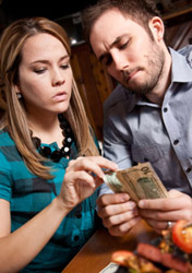Couple Figuring Out the Tip (Photo: iStockphoto/asiseeit)