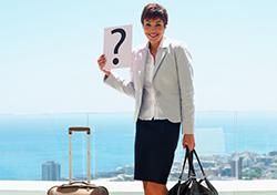 Traveler Holding Sign (Photo: Shutterstock.com)