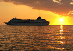 Cruise ship at sunset Photo