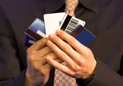 Credit Card: Man Holding a Range of Cards (Photo: iStockphoto/Andresr)