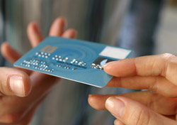 Credit Card: People Passing Card (Photo: iStockphoto/Marcus Clackson)