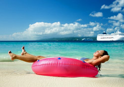 Cruise - Woman relaxing in a pink tube on a cruise vacation (Photo: Christian Wheatley)