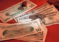 U.S. bills and coins (Photo: Index Open)