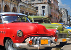 Cuba: Havana, Row of Colorful Vintage Cars (Photo: Thinkstock/iStockphoto)