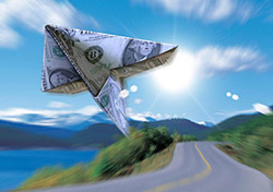 Dollar Bill Paper Plane (Photo: Thinkstock/Photos.com)