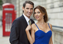 England: London, Couple Standing Next to Phone Booth (Photo: Shutterstock/Darren Baker)