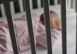 Baby in a crib (Photo: iStockphoto)