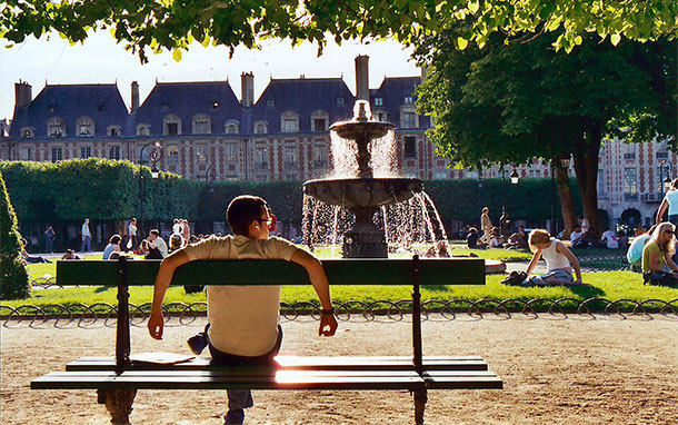 Man Relaxing on Bench in Parisian Park (Photo: Carol Ries)