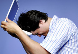 Frustrated Man with Laptop (Photo: Thinkstock/iStockphoto)