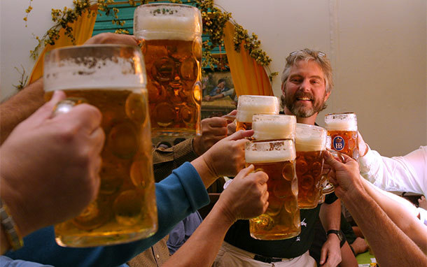 Friends Toasting at Beer Hall During Oktoberfest, Germany (Photo: Dominic Bonuccelli)