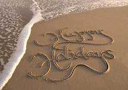 Happy Holidays Inscribed in Sand (Photo: iStockphoto/PeskyMonkey)