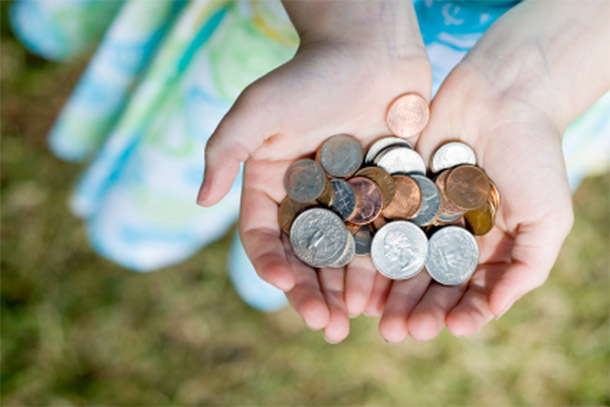 Hands Filled With Coins (Photo: iStockphoto/gwmullis)