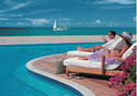 Four Seasons Resort Nevis, West Indies  One of the Caribbean's top luxury resorts, the Four Seasons Resort Nevis makes for a relaxing escape thanks in part to its location on the lesser-visited island of Nevis, a West Indies isle known for its natural beauty and lack of commercial buildup. There's plenty to do here, however. On-site you'll find an 18-hole Robert Trent Jones II-designed golf course, 10 tennis courts, and an award-winning spa. Rates from January 5 to February 15 start at $695 per night. You can stay for as little as $475 nightly through December 14.  (Photo: Four Seasons Resort Nevis)