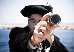 Columbus peering through a telescope (Photo: iStockphoto.com)