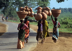 Women carrying clay pots in southern India (Photo: Adrian Chalker/Wildland Adventures)