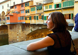 Woman looking from a bridge in Italy (Photo: IndexOpen)