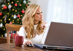 Searching for holiday fares online (Photo: iStockPhoto/Sean Locke)