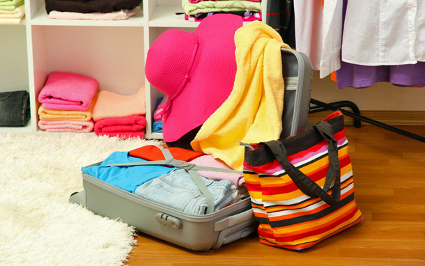 Luggage: Open Bag in Closet (Photo: Shutterstock/Africa Studio)