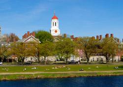 Harvard University Students relaxing along Charles River, Cambridge, Massachusetts (Photo: iStockphoto.com/ Jorge Salcedo)