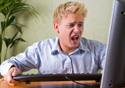 Man: Aghast and at Computer (Photo: Thinkstock/iStockphoto)
