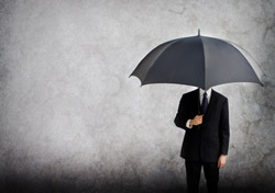 Man: Holding Umbrella, Indoors (Photo: Shutterstock/MnemosyneM)