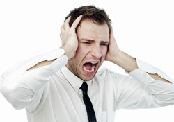 Man: Shocked Business Man (Photo: Thinkstock/iStockphoto)