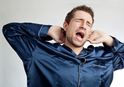 Man: Yawning, in Pajamas (Photo: Shutterstock/baranq)
