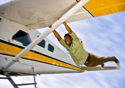Air: Man Holding Back of Flying Airplane (Photo: iStockphoto/Shelly Perry)