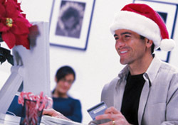Christmas: Man Shopping Online Santa Hat (Photo: Thinkstock/Comstock)