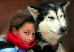 Sled dog and girl (Photo: Wintergreen Dogsledding)