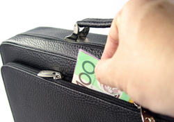 Hand Stealing Money out of Briefcase (Photo: Thinkstock/Hemera)