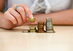 Money: Stacking Coins (Photo: Shutterstock/Ferenc Cegledi)