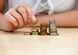 Money: Stacking Coins (Photo: Shutterstock/Ferenc Cegledi)