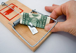 Money: Fingers with dollar caught in Mousetrap (Photo: iStockphoto/SpotX)