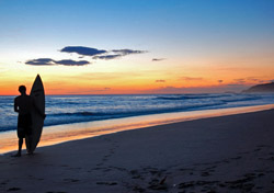 Surfer watches the sunset from the Pacific coast of Nicaragua (Photo: Ammon Cogdill/iStockphoto)