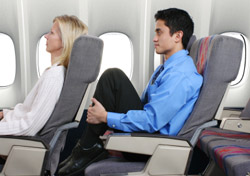 Air: Man with no legroom (Photo: iStockphoto/Gene Chutka)