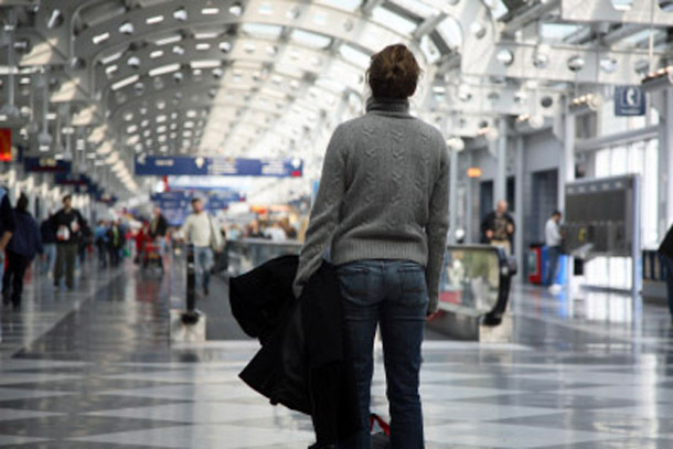 Airport: Frustrated, Overwhelmed Traveler (Photo:iStockphoto/Dystortia)