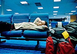 Passenger Sleeping at Airport Lounge (Photo: iStockphoto/Philartphace)