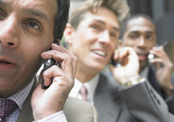 Businessmen Talking on Cell Phones (Photo: Blend Images/Shutterstock.com)