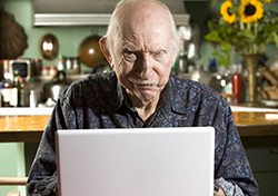 Grumpy Old Man on Computer (Photo: Shutterstock.com)