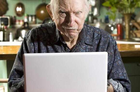Grumpy Old Man on Computer (Photo: Shutterstock.com)