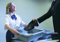 TSA Agent with Traveler (Photo: Thinkstock/Comstock)