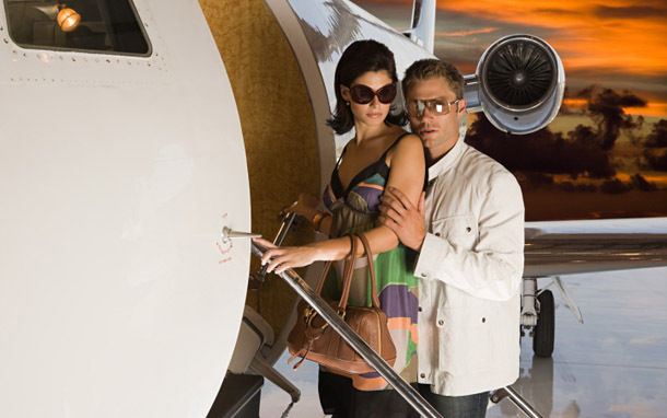 Wealthy Couple Boarding Private Jet (Photo: Thinkstock/Image Source)