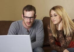 Young Couple with Laptop. (Photo: Thinkstock/iStockphoto)