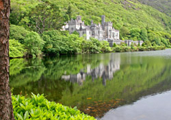 Hint: As the oldest of its kind, this place has served several different functions.  If you guessed the Kylemore Abbey in Ireland, you're right!  Located in the Connemara region, the Kylemore Abbey is the oldest of the Irish Benedictine Abbeys. The Abbey was built in 1871 by Mitchell Henry and his wife, and since that time has been used as a guesthouse, an international boarding school, a day school for local girls, and a residence for Benedictine nuns. The Gothic Church was built in honor of Henry's wife who died while on holiday in Egypt. Today, visitors can tour the grounds, which include a section of the abbey (the other sections are retained for the nuns), the Victorian walled gardens, the gothic church, and the final resting place of the Henrys.   The nearest major airport is in Shannon.  (Photo: iStockphoto/Nico Smit)