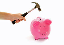Piggy Bank Smashed by a Hammer (Photo: iStockPhoto/Amanda Rohde)